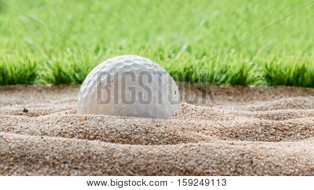 close up Golf ball in sand bunker