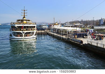 Istanbul Turkey - March 29 2013: Istanbul Ferries Eminonu waiting in the harbor. (called vapur in Turkish) continue to serve as a key public transport link for many Thousands of commuters tourists and vehicles per day.