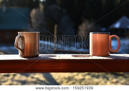 Morning Coffee Cups On A Balcony
