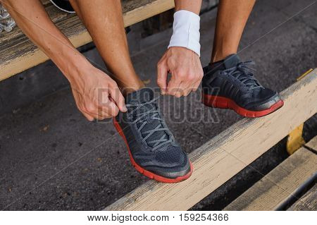 Runner tying shoelaces on sneakers. close up