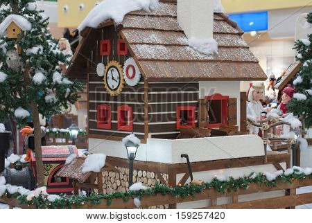 Wooden House With Elfs And Angels In Shopping Center