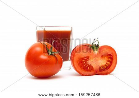 ripe tomatoes and glass of juice on a white background. horizontal photo.