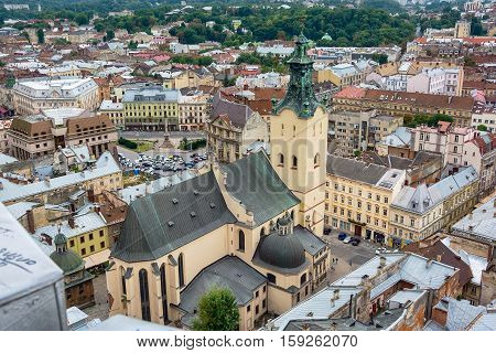 Lviv Ukraine old city vintage toned top view panorama with houses roofs and Latin Cathedral
