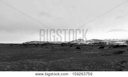 view across an ash beach on Iceland`s main tundra