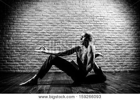Various difficult yoga poses. Yoga teacher doing exercises on yoga.
