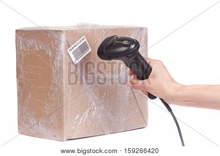 Close up of the barcode scanner during scanning of boxes of goods isolated on white background. Studio short.