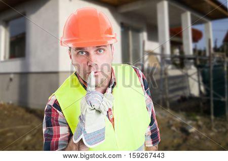 Portrait Of Male Engineer Doing Quite Gesture