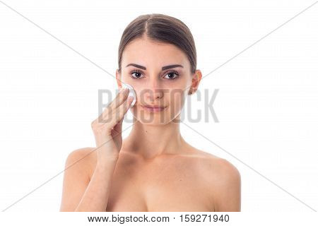 attractive Young girl takes care her skin with Cleansing cotton pad isolated on white background. Health care concept. Body care concept. Young woman with healthy skin.