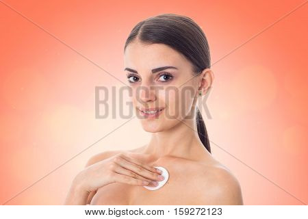 attractive girl takes care her skin with Cleansing cotton pad isolated on white background. Health care concept. Body care concept. Young woman with healthy skin.