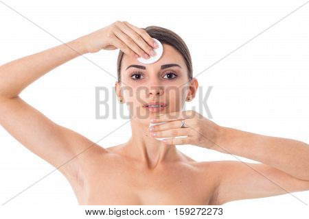 Young adorable girl takes care her skin with Cleansing cotton pad isolated on white background. Health care concept. Body care concept. Young woman with healthy skin.