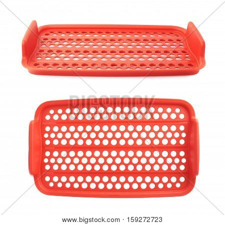 Red plastic tableware food container lattice isolated over the white background