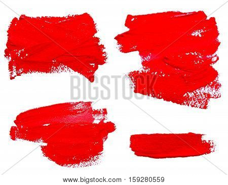 Collection of red strokes of the paint brush isolated on a white