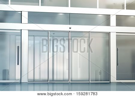 Blank sliding glass doors entrance mockup 3d rendering. Commercial automatic entry mock up. Office building exterior template. Closed transparent business centre facade front view.