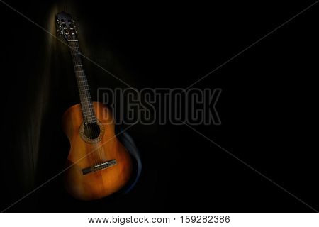 Acoustic six-string guitar with black copy space