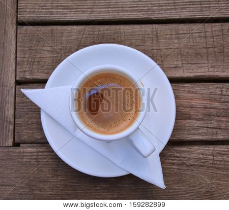 Greek style coffee cup on wooden table top view