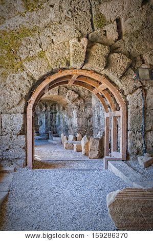 An archway made safe with a wooden frame within the ancient Roman amphitheatre situated in the turkish town of Side.