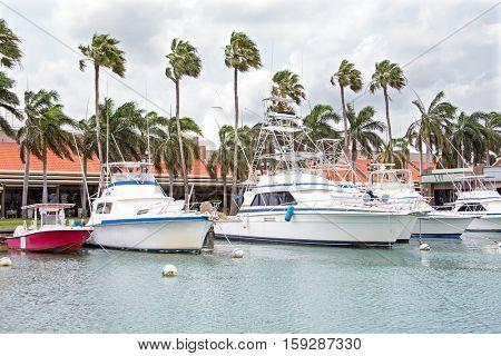 Boats in the harbor on Aruba island in Oranjestad in the Caribbean