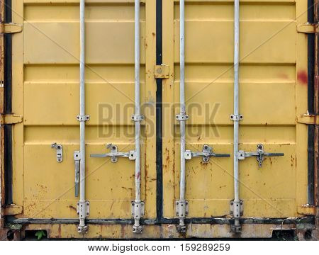 Metal yellow container for transportation of marine cargo. Front view.