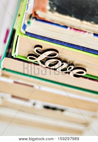 On A Stack Of Old Books Wooden Word Love