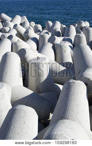 New gray concrete tetrapods in sunny day