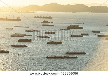 cargo ships carrying goods between ports