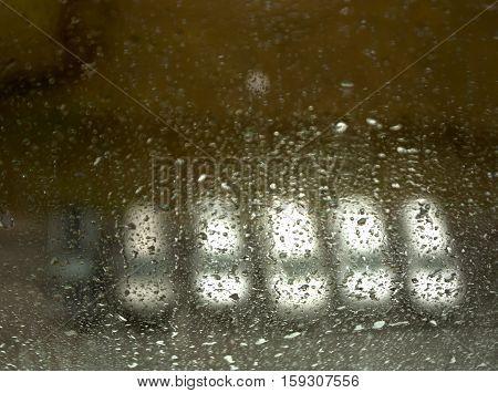 Cars On Parking In Blur Seen Through Wet Window.