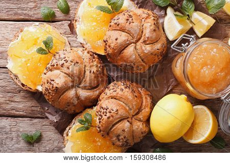 Buns With Lemon Jam, Mint And Butter On The Table Close-up. Horizontal Top View