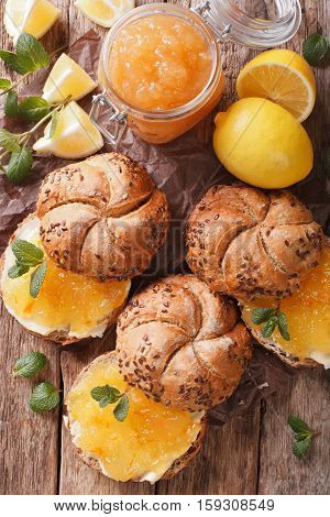 Buns With Lemon Jam, Mint And Butter On The Table Close-up. Vertical Top View, Rustic