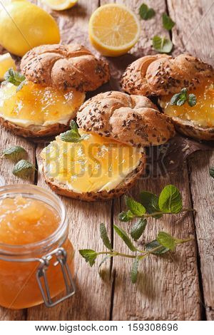 Sweet Sandwiches With Lemon Marmalade, Mint And Butter Close-up. Vertical