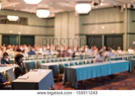 Blured image of audience in conference hall attending business conference. Business and Entrepreneurship concept.