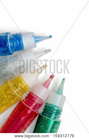Set of colored glitter glue tubes. Isolated on white with clipping path