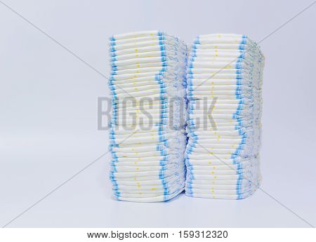 Stack of diapers on white background close up