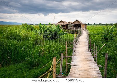 Traditional Asian Local Farm Houses And Wooden Bridge, Inle Lake, Myanmar