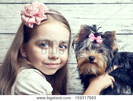 Girl with puppy of breed Yorkshire Terrier