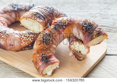 Bagels With Sesame Wrapped In Bacon Rashers
