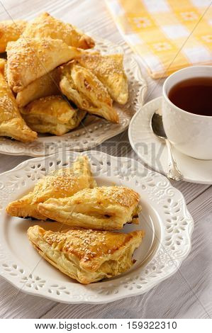 Puff pastry triangles filled with feta cheese and leek.