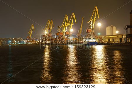 cranes at the port, cargo terminal, night, industrial