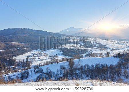 Winter fairytale, heavy snowfall covered the trees and houses in the mountain village.