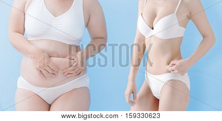 fat overweight woman and slim woman pinch their wait isolated on blue background asian