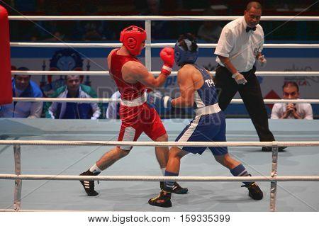 boxing uppercut right hand St. Petersburg Russia November 21 2016 AIBA Youth World Boxing Championships men heavy 81 kg. Boxing match between: RED- Rustamov S. Uzbekistan BLUE -Kan C. Taipei