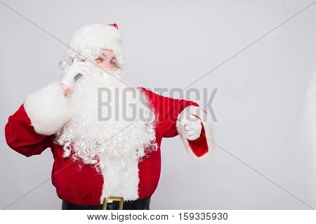Santa Claus talk on the Phone and look on the Watch.
