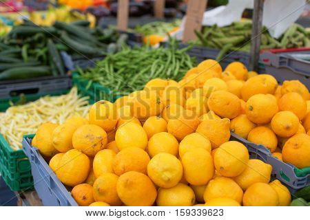 Ripe Lemons On A Market
