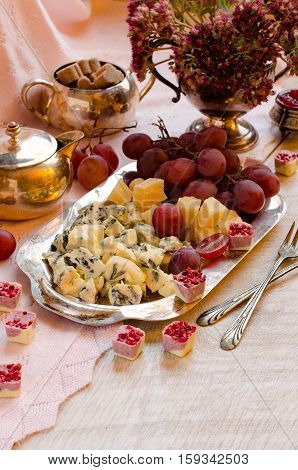 Cheese And Grapes On A Silver Platter.