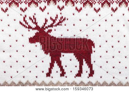 Knitted fabric with deer ornament