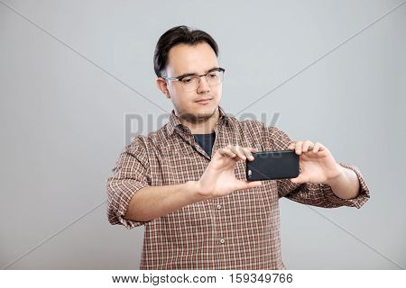 Young Businessman Taking Photos With Mobile Phone