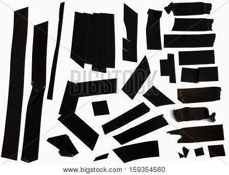 Collection of black adhesive electrical tape pieces