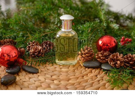 Christmas fir tree with oil and stones on on wicker woven mat mat