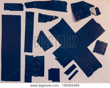 Collection of blue used duct tape pieces