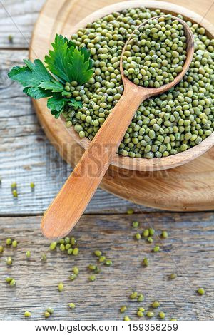 Wooden сup Of Mung Beans And Sprig Of Parsley.