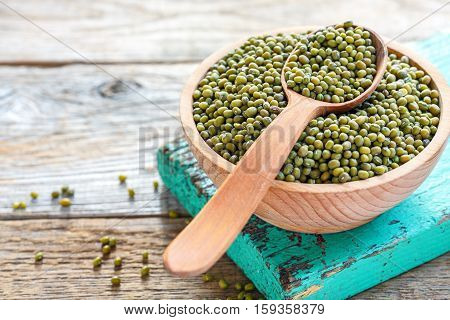 Green Mung Beans And Wooden Spoon In A Bowl.